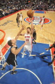Viacheslav Kravtsov of the Detroit Pistons shoots against Brook Lopez of the Brooklyn Nets on February 6 2013 at The Palace of Auburn Hills in Auburn...