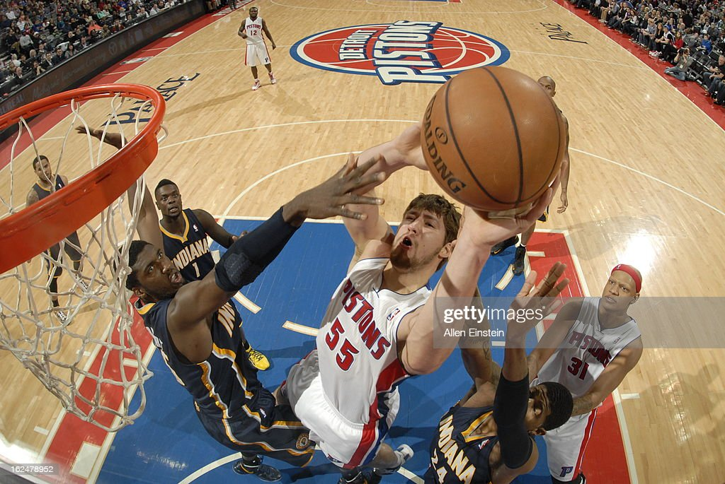 Viacheslav Kravtsov #55 of the Detroit Pistons shoots against <a gi-track='captionPersonalityLinkClicked' href=/galleries/search?phrase=Roy+Hibbert&family=editorial&specificpeople=725128 ng-click='$event.stopPropagation()'>Roy Hibbert</a> #55 of the Indiana Pacers on February 23, 2013 at The Palace of Auburn Hills in Auburn Hills, Michigan.