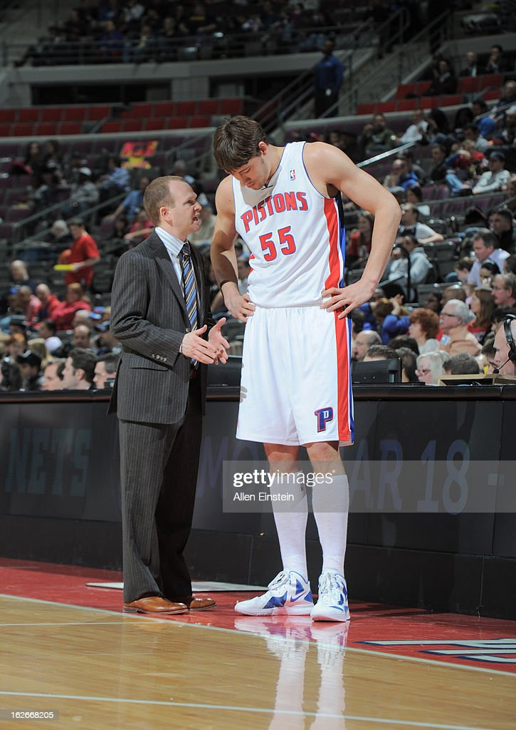 Viacheslav Kravtsov of the Detroit Pistons speaks with Head Coach Lawrence Frank of the Detroit Pistons during the game between the Detroit Pistons...