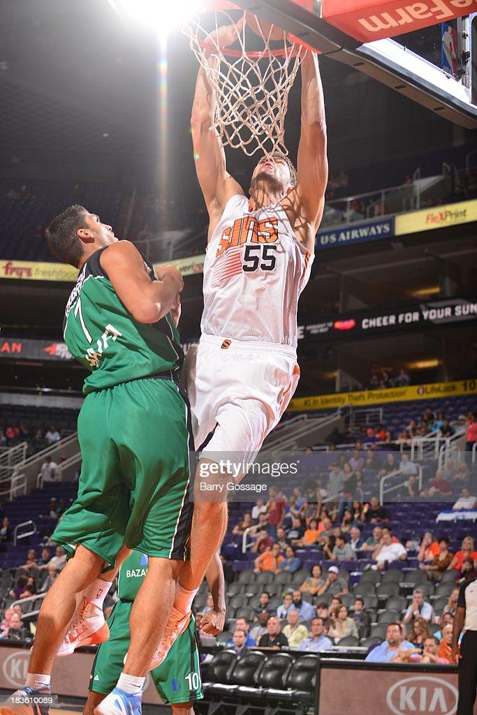 Viacheslav Kravtsov #55 of the Phoenix Suns dunks against Maccabi Haifa on October 7, 2013 at U.S. Airways Center in Phoenix, Arizona.