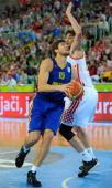 Viacheslav Kravtsov of Ukraine moves past Ante Tomic of Croatia during the FIBA Eurobasket quarter final match between Croatia and Ukraine at the...