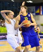 Viacheslav Kravtsov of Ukraine vies for the ball with Axel Hervelle of Belgium during the Group A European Basketball Championship match Belgium vs...