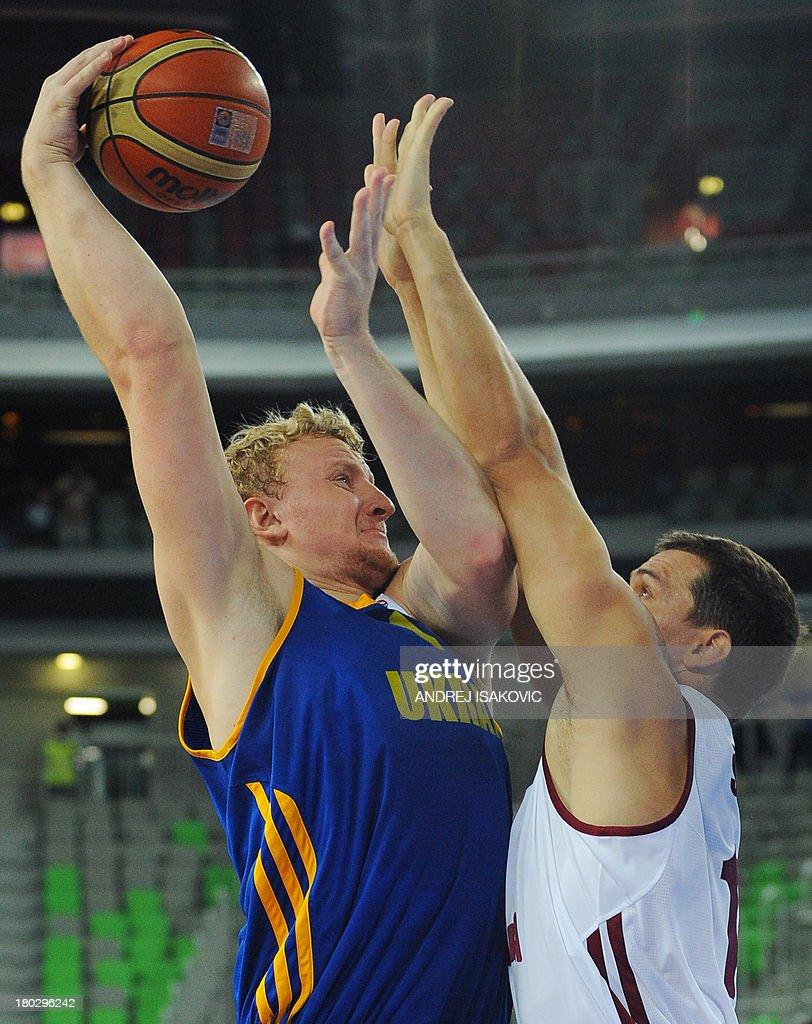 Viacheslav Kravtsov of Ukraine (L) vies with Andrejs Selakovs of Latvia during the FIBA EuroBasket second round Group E basketball championship qualification match between Latvia and Ukraine, in Ljubljana, Slovenia, on September 11, 2013.