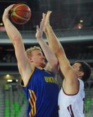 Viacheslav Kravtsov of Ukraine vies with Andrejs Selakovs of Latvia during the FIBA EuroBasket second round Group E basketball championship...