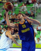 Viacheslav Kravtsov of Ukraine vies with Marco Cusin of Italy during their FIBA Eurobasket 58 place classification match between between Italy and...