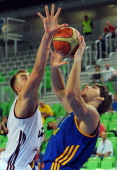 Viacheslav Kravtsov of Ukraine vies with Martins Meiers of Latvia during the FIBA EuroBasket second round Group E basketball championship...