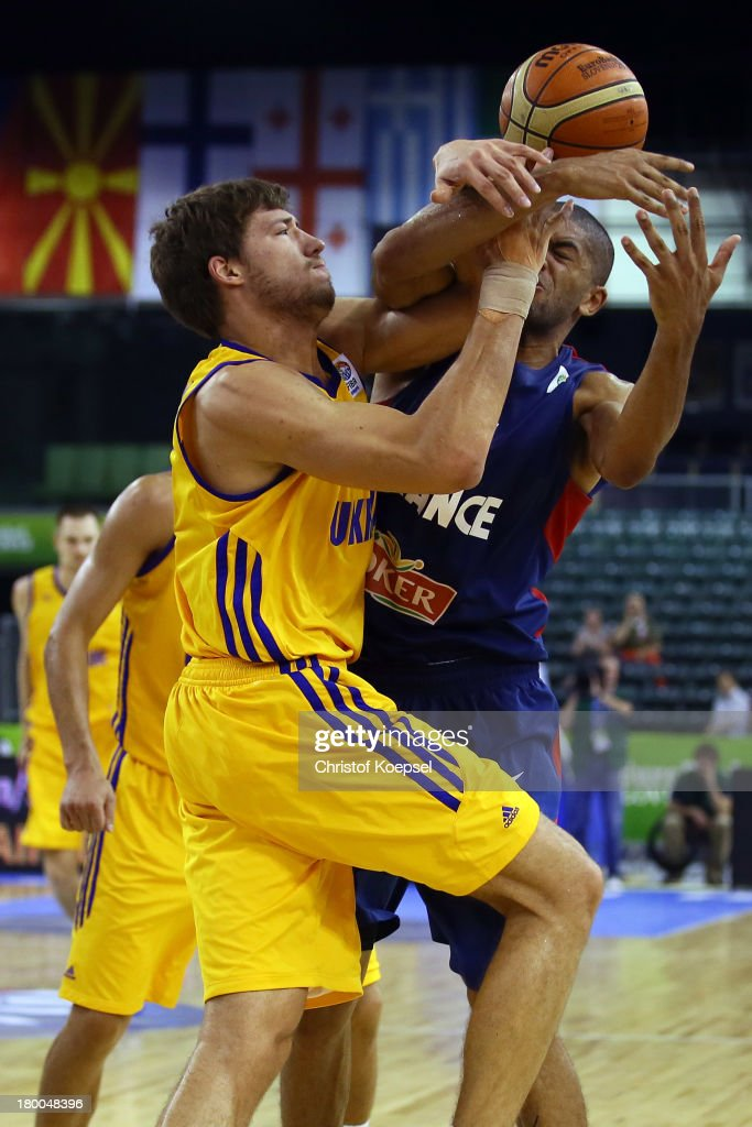 Viacheslav Kravtsov of Ukriane and Nicolas Batum of France fight for the ball during the FIBA European Championships 2013 first round group A match...