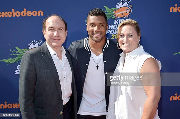 Viacom CEO Philippe Dauman NFL player Russell Wilson and president of Nickelodeon Networks Cyma Zarghami attend the Nickelodeon Kids' Choice Sports...