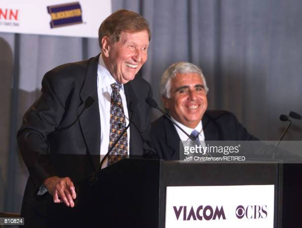 Viacom CEO Sumner Redstone left talks to reporters and CBS CEO Mel Karmazin listens as they announced an agreement to merge the two companies during...