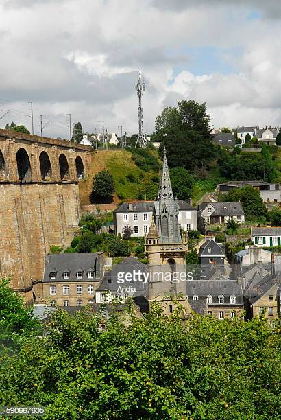 Viaduct Church of SaintMelaine Hotel 'Francois du Parc' in Morlaix in the Leon country with foliage in the foreground 2007