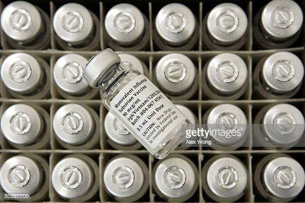 A vial of experimental flu vaccine is seen during a clinical trial to test the effectiveness of the vaccine to combat avian influenza April 5 2005 at...