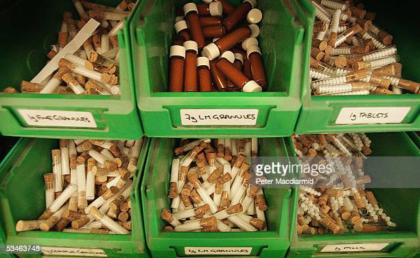 Vials and test tubes containg granules and pills for homeopathic remedies are displayed at Ainsworths Pharmacy on August 26 2005 in London British...