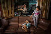 Viboonsri Wongsangiym and Wiboonsri and her husband Bang Aree have made a living by producing Muslim garment at home in a Lam Hin Tai community a...