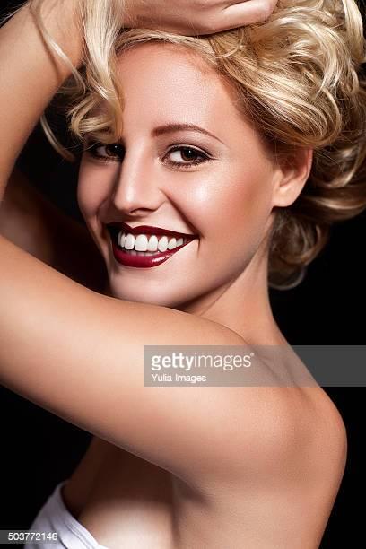 Vibrant Blond Woman Smiling Over Shoulder