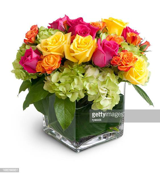 Vibrant Floral Arrangement in Square Crystal Vase Isolated
