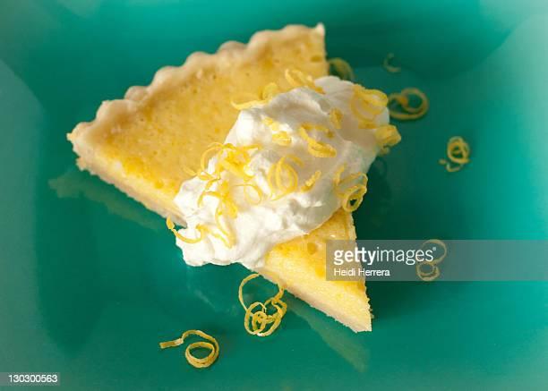 Vibrant lemon tart on aqua plate