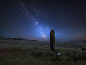 Stunning vibrant Milky Way composite image over landscape of Ancient prehistoric stones in Wales