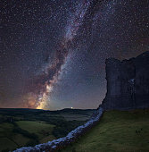 Stunning vibrant Milky Way composite image over landscape of medieval castle ruins