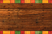 Rustic dark wood planks with vibrant colored borders for Mexican style backgrounds