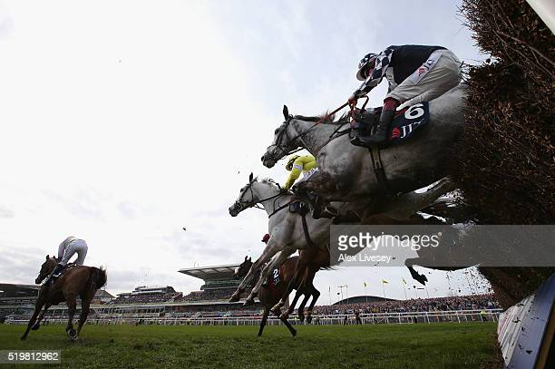 Vibrato Valtat ridden by Sam TwistonDavies clears a fence clears the last during the JLT Melling Chase at Aintree Racecourse on April 8 2016 in...