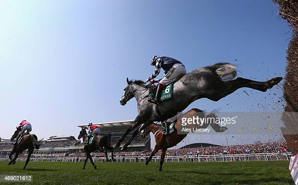 Vibrato Valtat ridden by Sam TwistonDavies clears a fence during the One Magnificent City Manifesto Novices' Steeple Chase at Aintree Racecourse on...