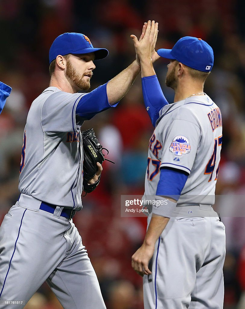 Vic Black #38 of the New York Mets is congratulated by Andrew Brown #47 after th 4-2 Mets victory over the Cincinnati Reds at Great American Ball Park on September 24, 2013 in Cincinnati, Ohio.