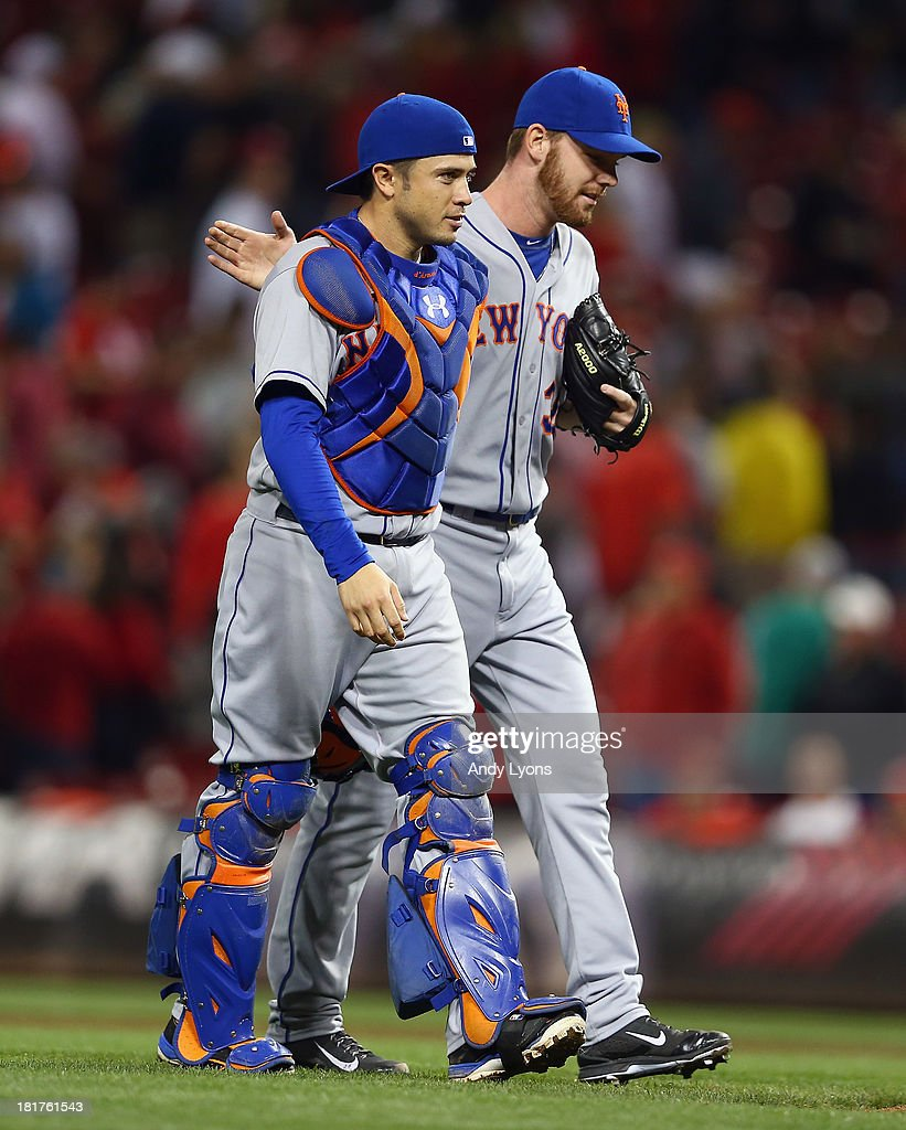 Vic Black #38 of the New York Mets is congratulated by Travis d'Arnaud #15 after the 4-2 Mets victory over the Cincinnati Reds at Great American Ball Park on September 24, 2013 in Cincinnati, Ohio.