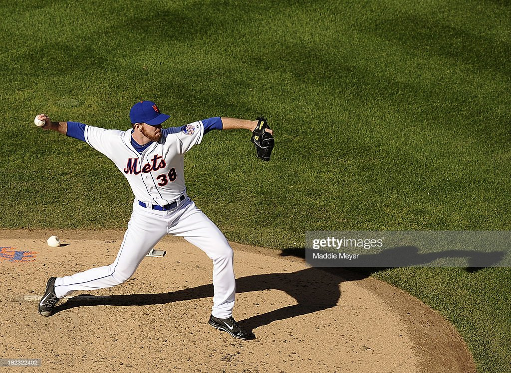 Vic Black #38 of the New York Mets throws towards first during the game against the Milwaukee Brewers at Citi Field on September 29, 2013 in New York City.