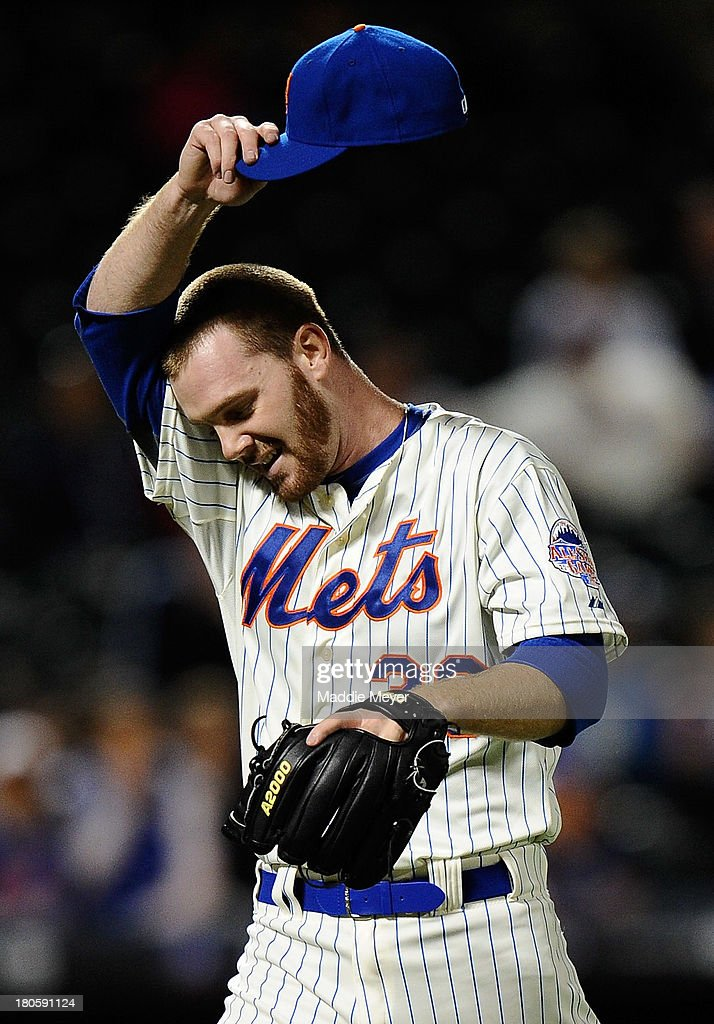 Vic Black #38 of the New York Mets wipes his brow after pitching the eighth inning of game two of a doubleheader against the Miami Marlins on September 14, 2013 at Citi Field in the Flushing neighborhood of the Queens borough of New York City. The Mets defeated the Marlins 3-1.