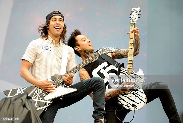 Vic Fuentes and Tony Perry of Pierce The Veil perform on Day 3 of The Leeds Festival at Bramham Park on August 30 2015 in Leeds England