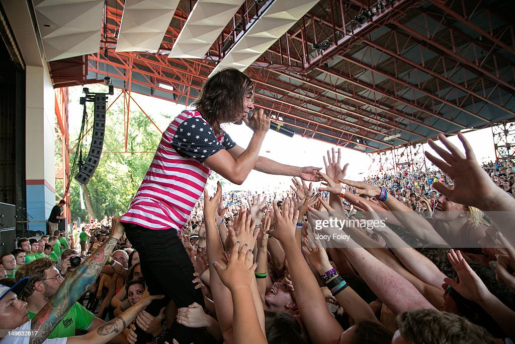Vic Fuentes of Pierce the Veil performs live to the crowd during the 2012 Vans Warped Tour at the Riverbend Music Center on July 31, 2012 in Cincinnati, Ohio.
