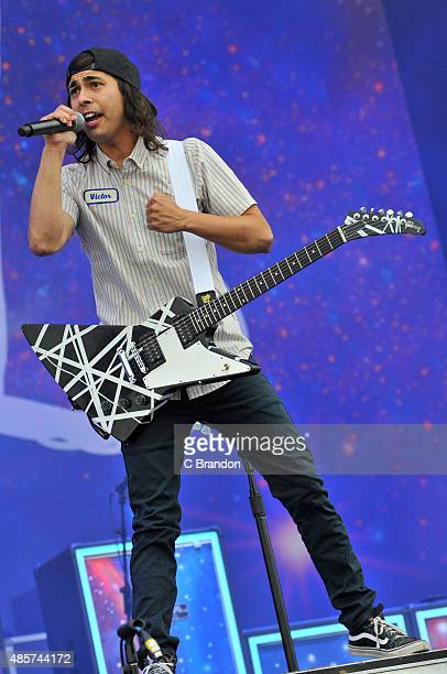 Vic Fuentes of Pierce The Veil performs on stage during the 2nd Day of the Reading Festival at Richfield Avenue on August 29 2015 in Reading England
