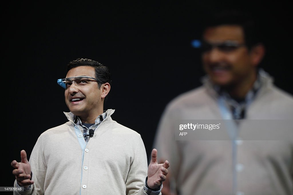 Vic Gundotra, senior vice president of engineering at Google, appears in front of the attendees with a Google Glass to start the keynote at Google's annual developer conference, Google I/O, in San Francisco on June 28, 2012 in California. AFP PHOTO / Kimihiro Hoshino