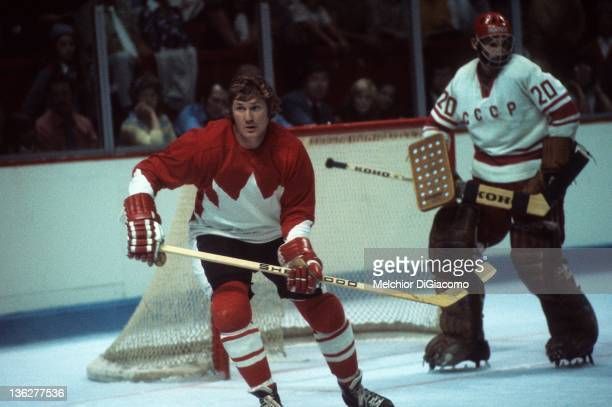 Vic Hadfield of Canada skates on the ice as goalie Vladislav Tretiak of the Soviet Union defends the net during Game 1 of the 1972 Summit Series on...