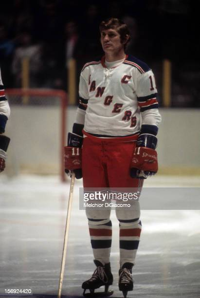 Vic Hadfield of the New York Rangers stands on the ice during the national anthem before an NHL game circa 1973 at the Madison Square Garden in New...