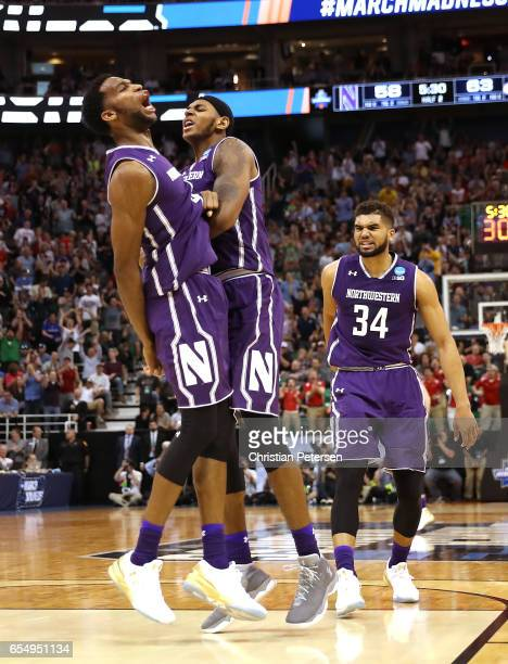 Vic Law Dererk Pardon and Sanjay Lumpkin of the Northwestern Wildcats celebrate against the Gonzaga Bulldogs during the second round of the 2017 NCAA...
