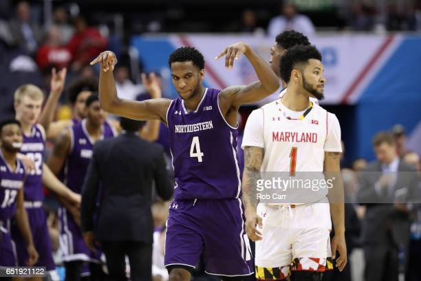 Vic Law of the Northwestern Wildcats celebrates in front of Jaylen Brantley of the Maryland Terrapins during the closing seconds of their 7264 win...