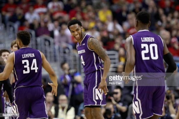 Vic Law of the Northwestern Wildcats reacts after making a basket against the Maryland Terrapins during the Big Ten Basketball Tournament at Verizon...