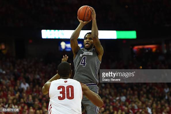 Vic Law of the Northwestern Wildcats shoots over Vitto Brown of the Wisconsin Badgers during the first half of a game at the Kohl Center on February...