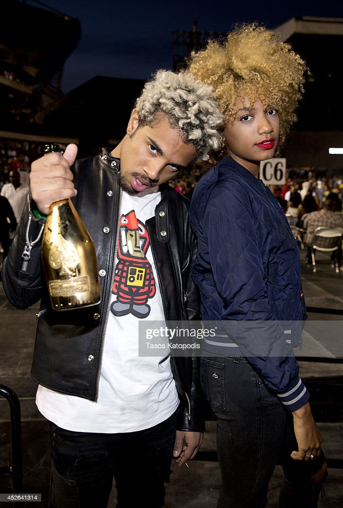 <a gi-track='captionPersonalityLinkClicked' href=/galleries/search?phrase=Vic+Mensa&family=editorial&specificpeople=9449887 ng-click='$event.stopPropagation()'>Vic Mensa</a> and Natalie Wright attend the D'USSE VIP Riser and Lounge at On The Run Tour Chicago at Soldier Field on July 24, 2014 in Chicago, Illinois.