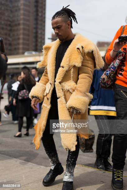Vic Mensa is seen attending Coach during New York Fashion Week wearing a fur coat on September 12 2017 in New York City