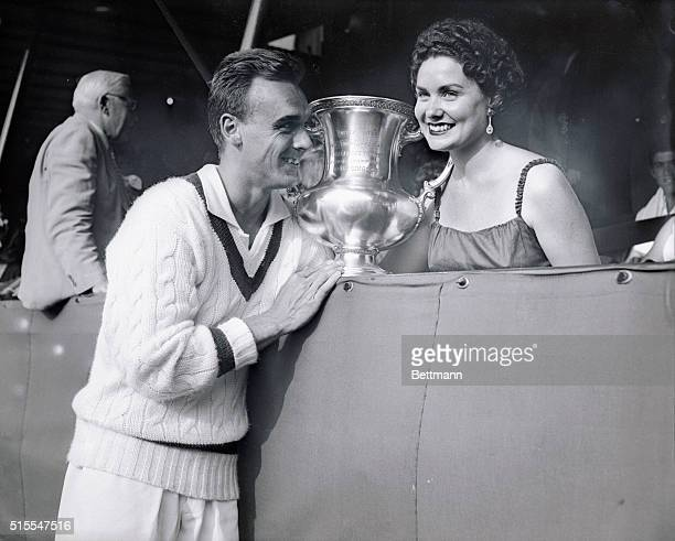 Vic Seixas 1953 Wimbledon champ is shown with his wife and trophy after winning the US Amateur Tennis Crown today Going to bat for the third time in...