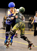 Vic Tori Bee of Manchester Roller Derby's Checkerbroads bouts against Dropkick Molly of Portsmouth Roller Wenches in the Tattoo Freeze Roller Derby...