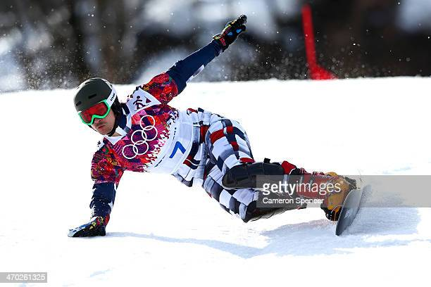 Vic Wild of Russia competes in the Snowboard Men's Parallel Giant Slalom Finals on day twelve of the 2014 Winter Olympics at Rosa Khutor Extreme Park...