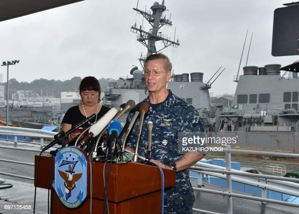 Vice Adm Joseph Aucoin Commander of the US 7th Fleet delivers a speech during a press conference in front of the guided missile destroyer USS...