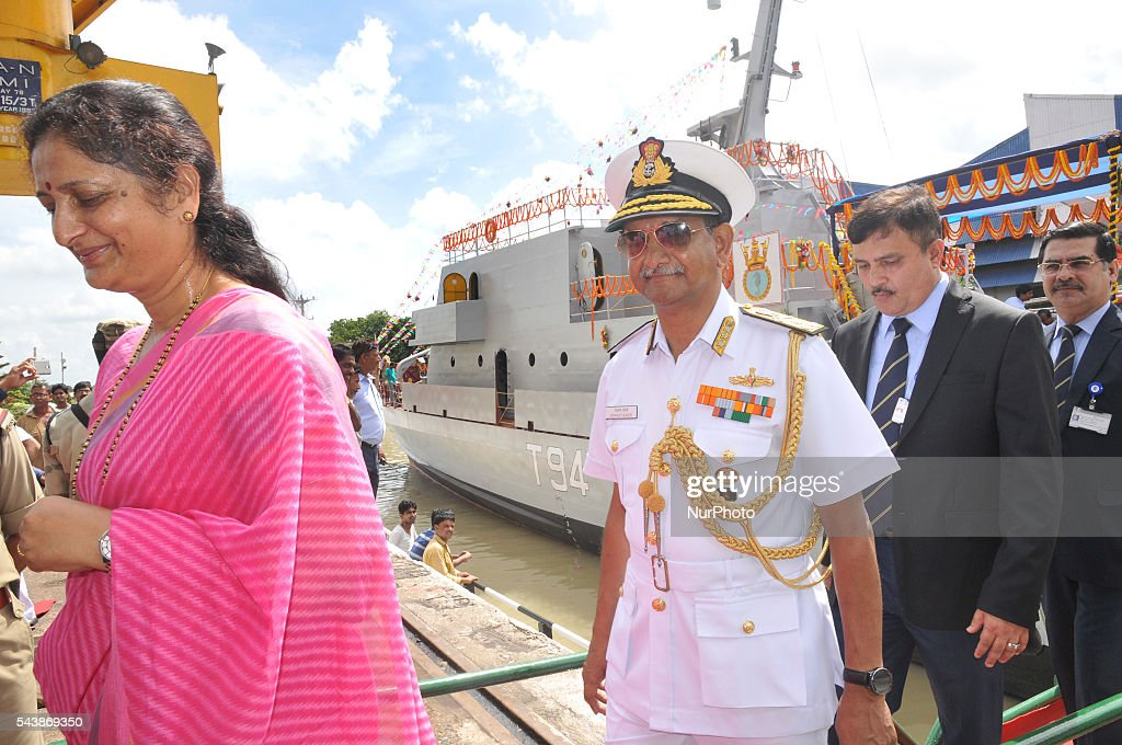 "Vice Admiral Jaywant Korde,AVSM,VSM Controller of Logistics Indian Navy along Smt.Aruna Korde at the flag off The fourth in the series of four ""Water Jet Fast Attack Craft"" (WJFAC) being built for the Indian Navy by Garden reach Shipbuilders & Engineers Ltd (GRSE) lunching ceremony in Kolkata, India, on 30 June 2016."