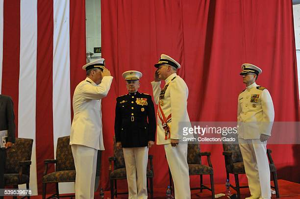Vice Admiral John Miller left relieves Vice Admiral Mark Fox as commander of US Khalifa Bin Salman Port Bahrain 2012 Image courtesy Mass...