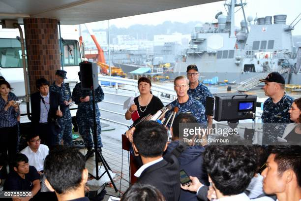 Vice Admiral Joseph Aucoin commander of the US Navy's 7th Fleet speaks during a news conference with the damaged USS Fitzgerald as background at the...