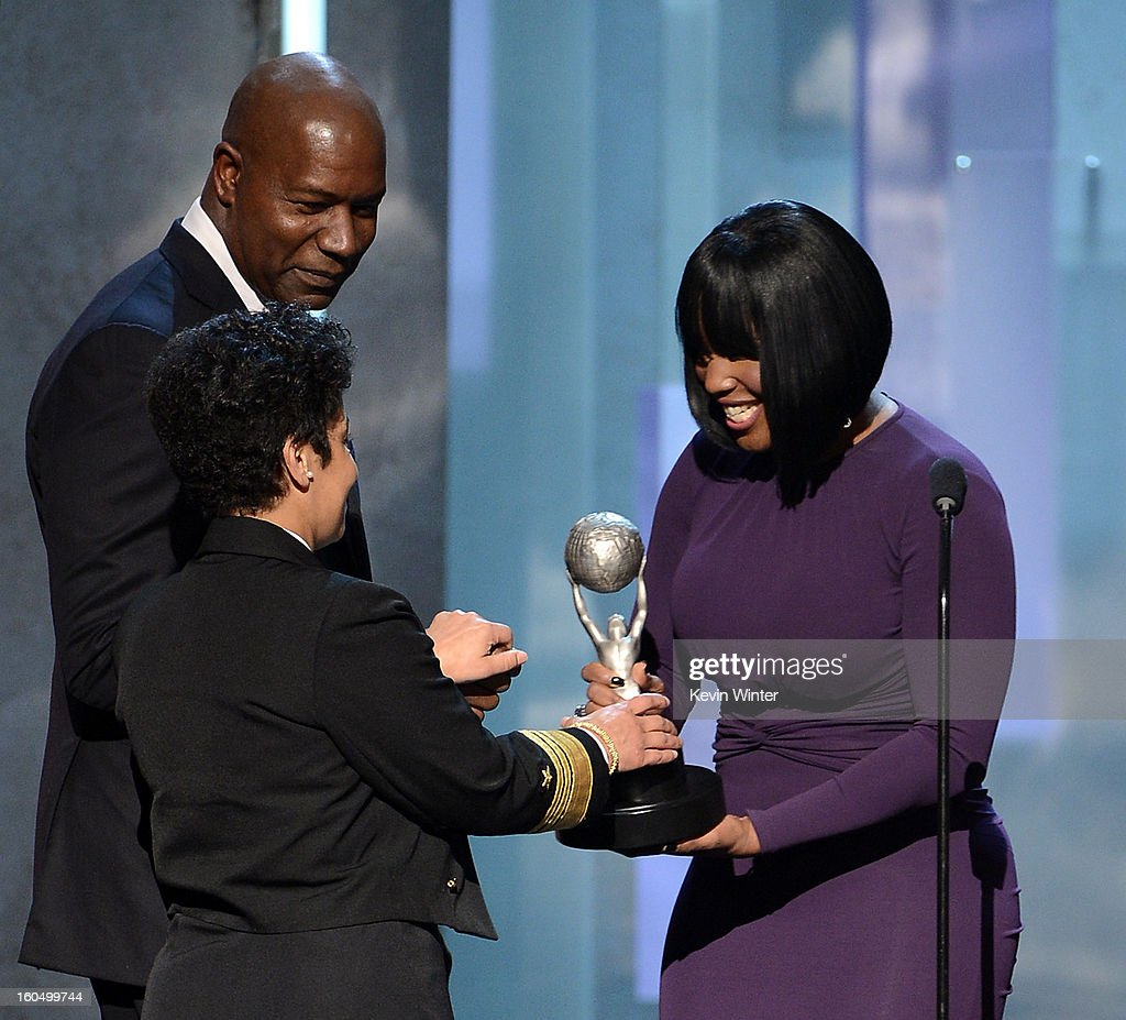 Vice Admiral Michelle Howard (C) accepts the Chairman's Award onstage from actor Dennis Haysbert (L) and NAACP Chairman of the National Board of Directors Roslyn M. Brock (R) during the 44th NAACP Image Awards at The Shrine Auditorium on February 1, 2013 in Los Angeles, California.