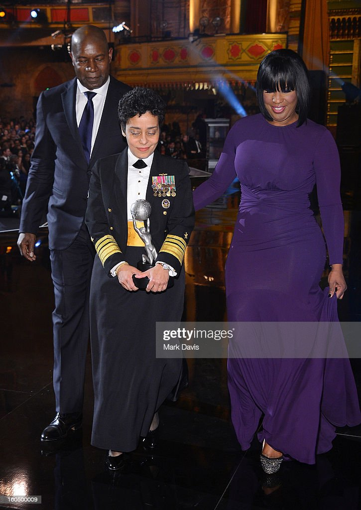 Vice Admiral Michelle Howard (C) accepts the Chairman's Award onstage from actor Dennis Haysbert (L) and NAACP Chairman of the National Board of Directors Roslyn M. Brock (R) attend the 44th NAACP Image Awards at The Shrine Auditorium on February 1, 2013 in Los Angeles, California.